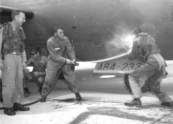 WGDCR John Whitehead (CO 2SQN), and Graham (OpsO 2SQN) hosing down Brian Hammond after his last operational sortie from Phan Rang.